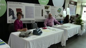"""Beth displaying the """"Envisioning Technologies"""" exhibit at Carleton University Life Science Day with colleague and Social Worker Roy Hanes."""