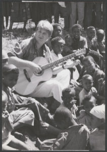 Citation from LAC: MIKAN 4368795 'Not so far away:' Tom Cochrane finds that music is indeed the international language as he entertains Ethiopian villagers with a tune. The singer, an official endorser of World Vision Canada's 30 HOUR FAMINE fund raising program, visited the agency's reforestation project in southern Ethiopia during his 12-day tour of four African countries. Omosheleko, Ethiopia, November 1990.